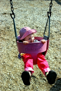 Fiona in a baby swing.