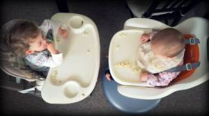 Kids in highchairs, an aerial view.