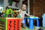 Petra standing between two standing toy like a DJ at her two turntables.