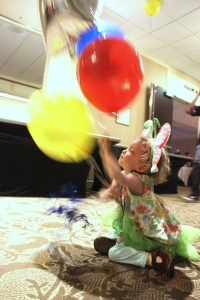 Fiona and balloons in motion