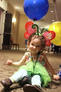 Fiona with balloons and a butterfly hat