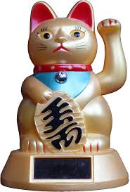 Lucky Cat. When I lived in Japan, these bobbed in all the shops and restaurants.