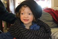 Fiona smiling in a black winter hat and thick gray scarf.