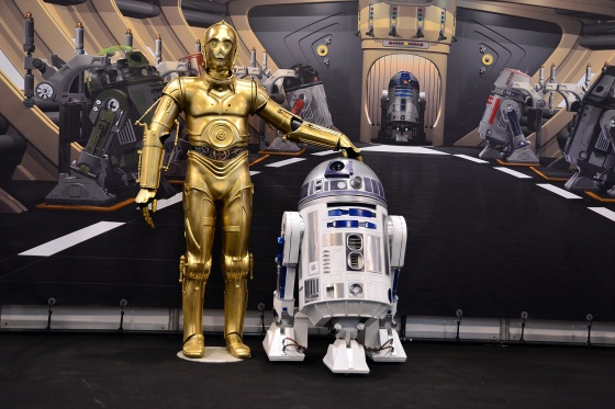 [Image description: Photograph of Star Wars characters C3PO and R2 D2, standing together on a spaceship.]