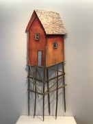 The most feasible of Hite's sculptures: a red barn, but on three layers of exceptionally long stilts. No stairs go up to the gray door.